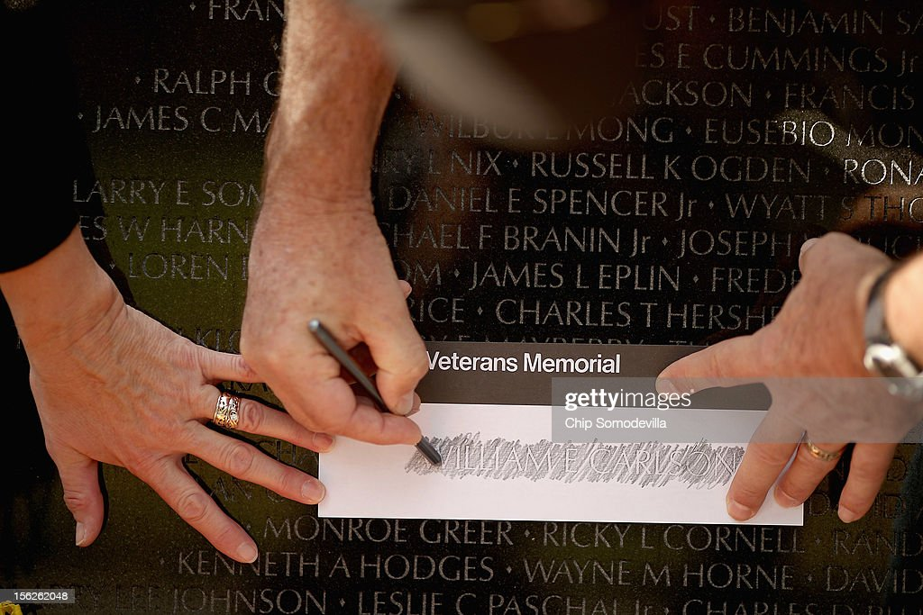U.S. Army veteran James Clemenson of Vergas, Minnesota, and his wife Rosie make a rubbing from a name on the Vietnam Veterans Memorial the day after Veterans Day, November 12, 2012 in Washington, DC. From 1970 to 1972, James Clemenson did two tours during the Vietnam War and was the last enlisted Vietnam veteran in the U.S. Air Force after serving for 41 years, 4 months and two days, he said.