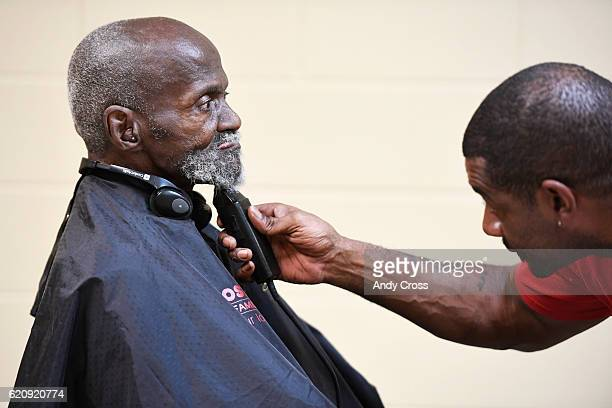 Army veteran Leroy Gamble gets his beard trimmed by volunteer Kavon Horton at the 26th annual Homeless Veterans Stand Down at the Colorado Army...