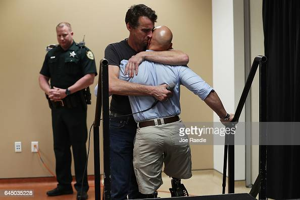 S Army Veteran Peter Hesford hugs Rep Brian Mast after he was overcome with emotion when speaking about veteran's suicides and he told Rep Mast 'that...