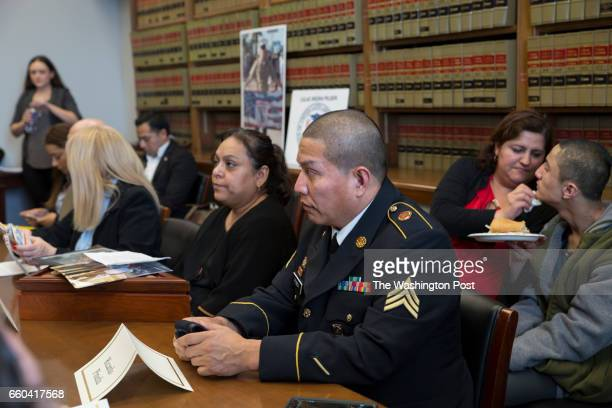 Army veteran Ricardo Pineda with his wife and son and other military families and supporters attend a meeting with members of the Congressional...
