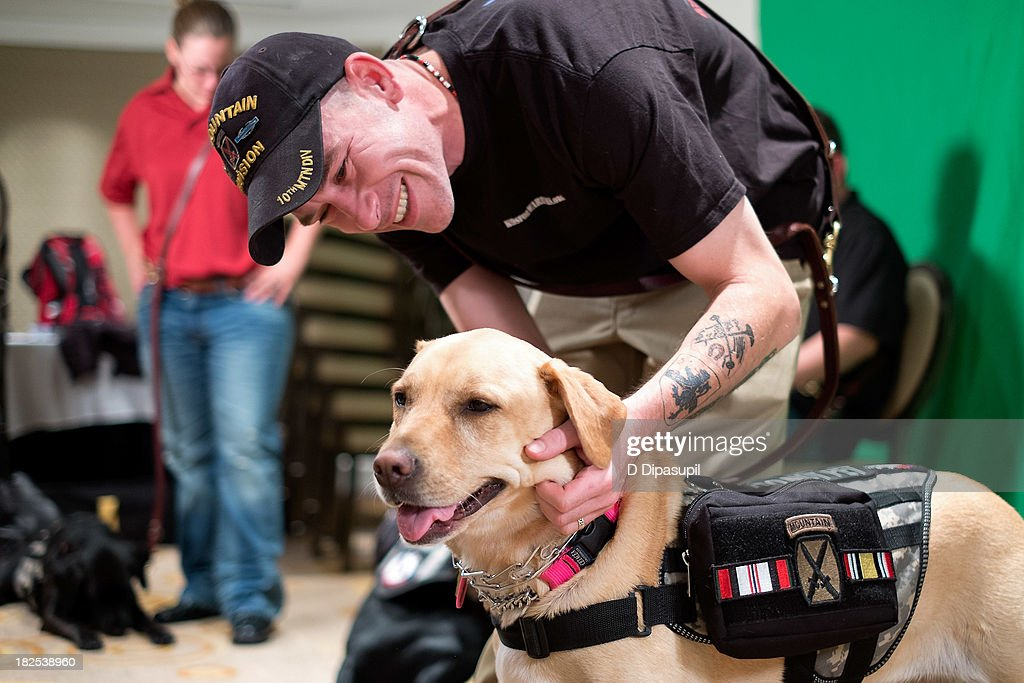 U.S. Army veteran Steven Boyd and his service dog Torii attend Animalfair.com's Bark Business Tour Benefiting K9s For Warriors at the Omni Berkshire Place Hotel on September 30, 2013 in New York City.