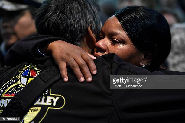 Army veteran Tatiana McLee right hugs a member of the Standing Rock Sioux tribe during an emotional forgiveness ceremony at the Four Prairie Knights...