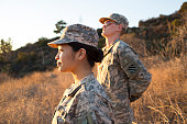 Army woman and man looking toward sunset