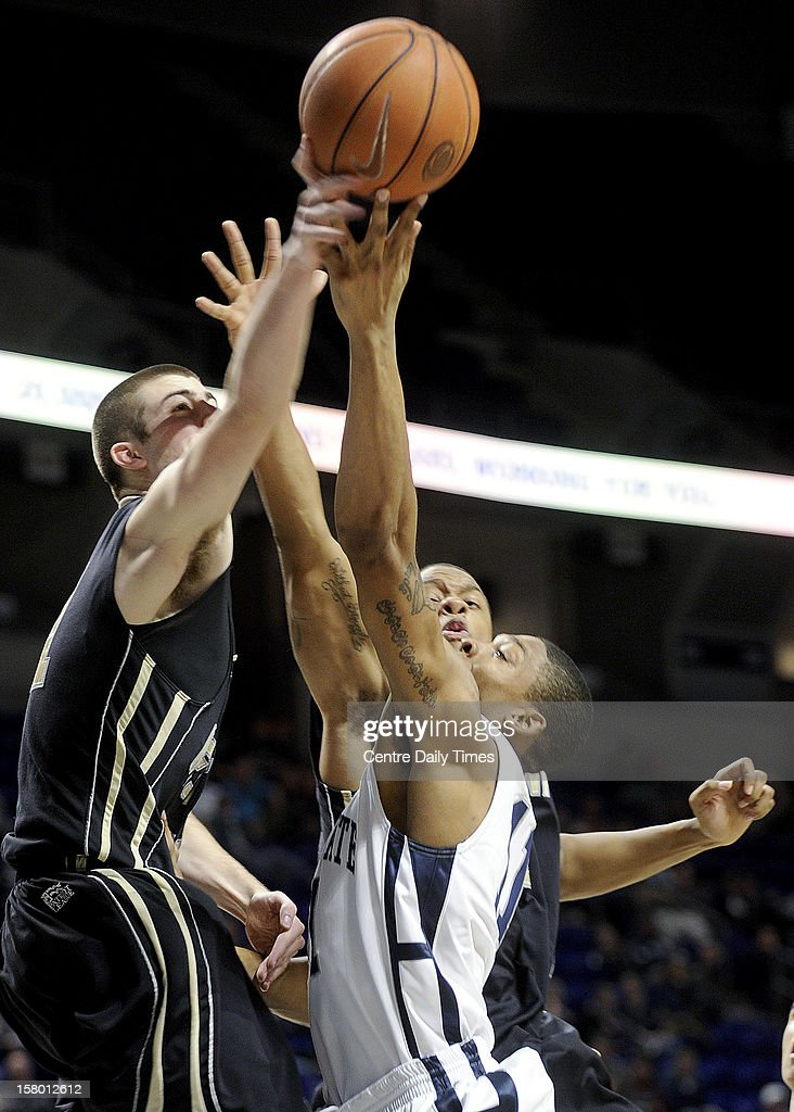 Army's Dylan Cox, left, blocks the shot of Penn State's Jermaine Marshall on Saturday, December 8, 2012, at the Bryce Jordan Center in University Park, Pennsylvania. Penn State topped Army, 78-70.
