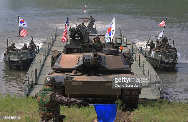 S Army's M1A2 tank and soldiers from 2nd Battalion 9th Infantry Regiment of the 1st Armored Brigade Combat Team of 2nd infantry division and South...