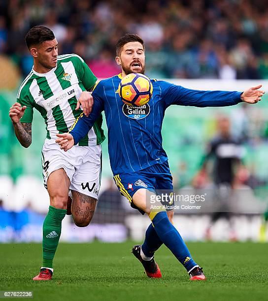 Arnaldo Antonio Sanabria of Real Betis Balompie competes for the ball with Andreu Fontas of RC Celta de Vigo during La Liga match between Real Betis...