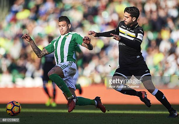 Arnaldo Antonio Sanabria of Real Betis Balompie competes for the ball with Pablo Insua of CD Leganes during La Liga match between Real Betis Balompie...