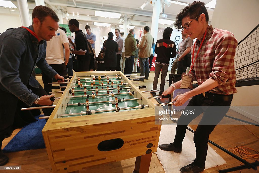 Arnaldo Capo (R) and Paul Schumacher play foosball while attending the NYC Uncubed tech recruiting event on May 17, 2013 in New York City. 1,100 people were expected to attend the unconventional employment event featuring 50 New York City based startups offering skills classes, ping pong, and beer and wine. Around 1,000 tech companies now operate in the city with the industry having grown by 30 percent since 2005.