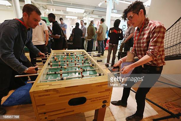 Arnaldo Capo and Paul Schumacher play foosball while attending the NYC Uncubed tech recruiting event on May 17 2013 in New York City 1100 people were...