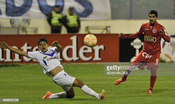 Arnaldo Vera of San Jose and German Pacheco of Juan Aurich vie for the ball during their Libertadores Cup football match in Oruro Bolivia on April 07...