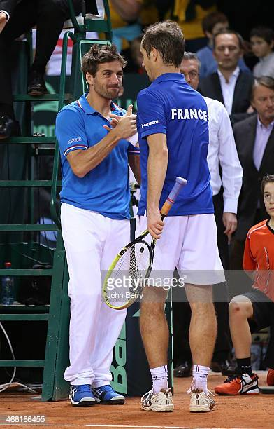 Arnaud Clement captain of France congratulates Richard Gasquet after his victory during the 1st round Davis Cup tie between France and Australia at...