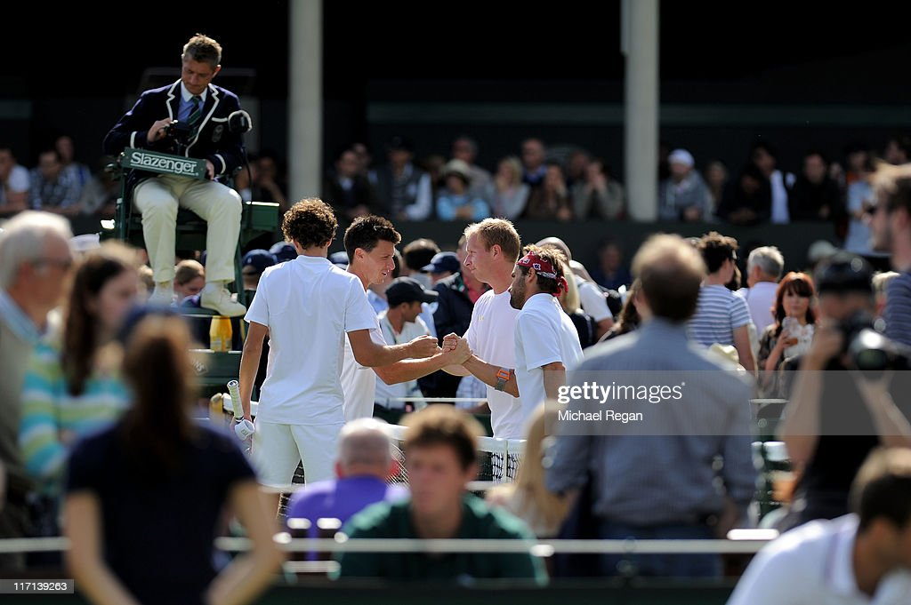 Arnaud Clement of France and Lukas Dlouhy of the Czech Republic shake hands with Robin Haase of the Netherlands and Kenneth Skupski of Great Britain...