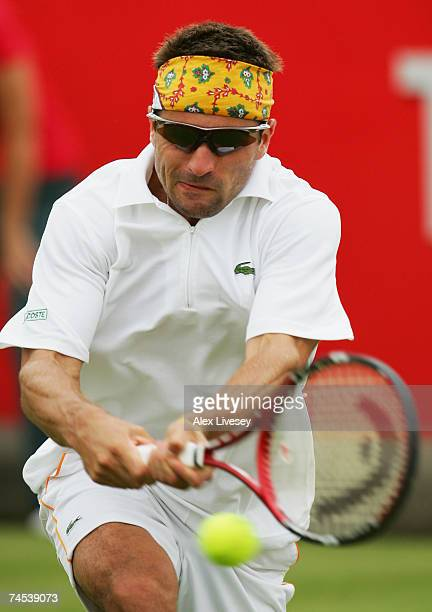 Arnaud Clement of France hits a backhand during the first round singles match against Ivan Navarro Pastor of Spain during Day 1 of the Artois...