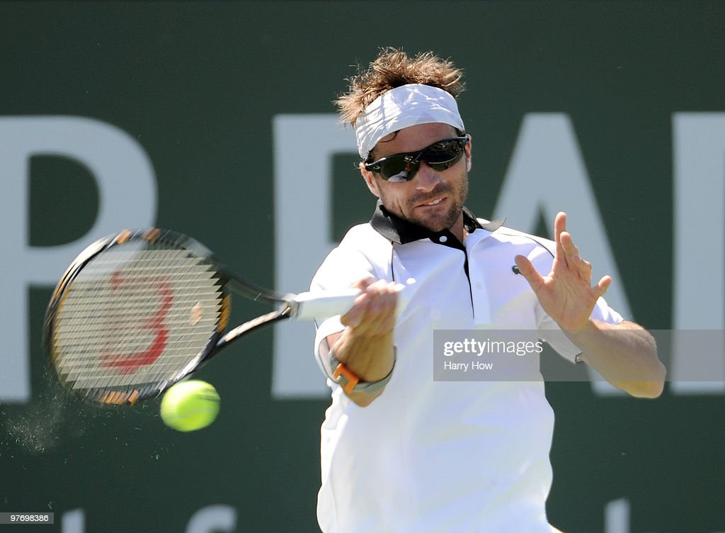 <a gi-track='captionPersonalityLinkClicked' href=/galleries/search?phrase=Arnaud+Clement&family=editorial&specificpeople=203192 ng-click='$event.stopPropagation()'>Arnaud Clement</a> of France hits a forehand in his match with Marcos Baghdatis of Cyprus during the BNP Paribas Open at the Indian Wells Tennis Garden on March 14, 2010 in Indian Wells, California.