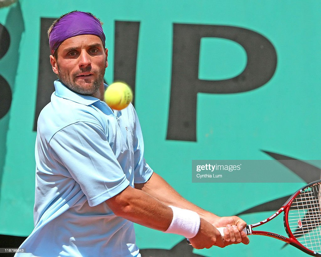 <a gi-track='captionPersonalityLinkClicked' href=/galleries/search?phrase=Arnaud+Clement&family=editorial&specificpeople=203192 ng-click='$event.stopPropagation()'>Arnaud Clement</a> of France, in action during his 3 set loss to <a gi-track='captionPersonalityLinkClicked' href=/galleries/search?phrase=Ivan+Ljubicic&family=editorial&specificpeople=213026 ng-click='$event.stopPropagation()'>Ivan Ljubicic</a> of Croatia in the first round of the French Open, at Roland Garros, Paris, France on May 29, 2007.