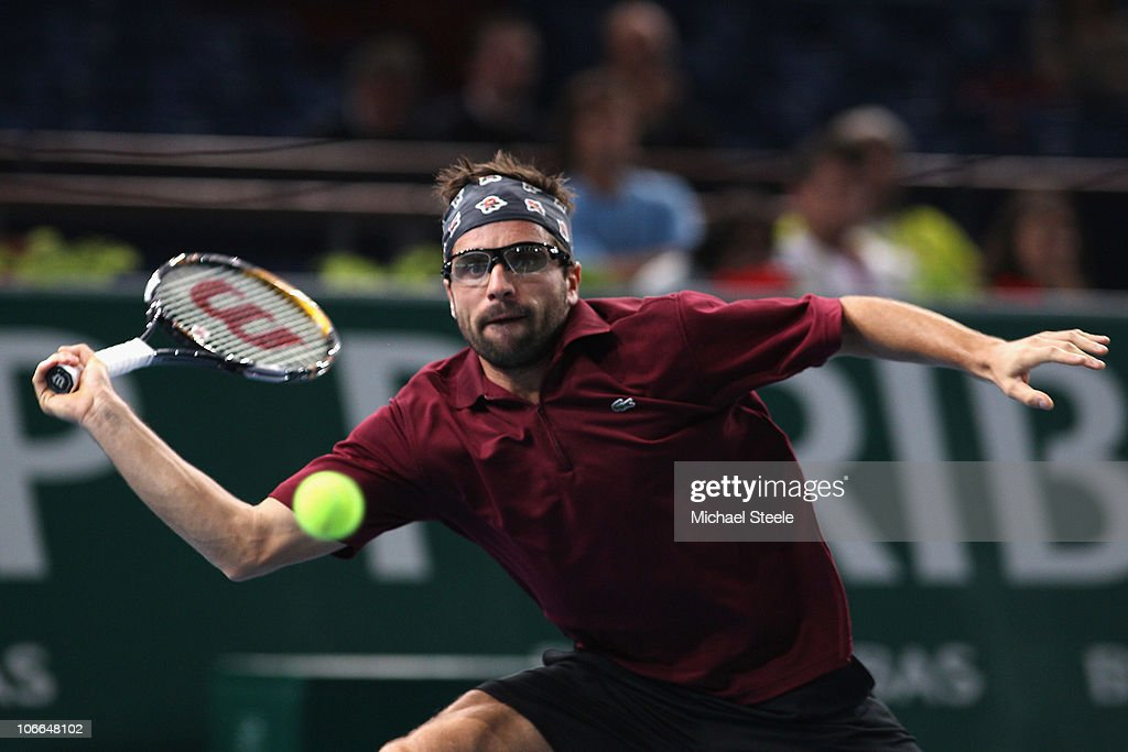 <a gi-track='captionPersonalityLinkClicked' href=/galleries/search?phrase=Arnaud+Clement&family=editorial&specificpeople=203192 ng-click='$event.stopPropagation()'>Arnaud Clement</a> of France in action during his second round match against Fernando Verdasco of Spain during Day Three of the ATP Masters Series Paris at the Palais Omnisports on November 9, 2010 in Paris, France.