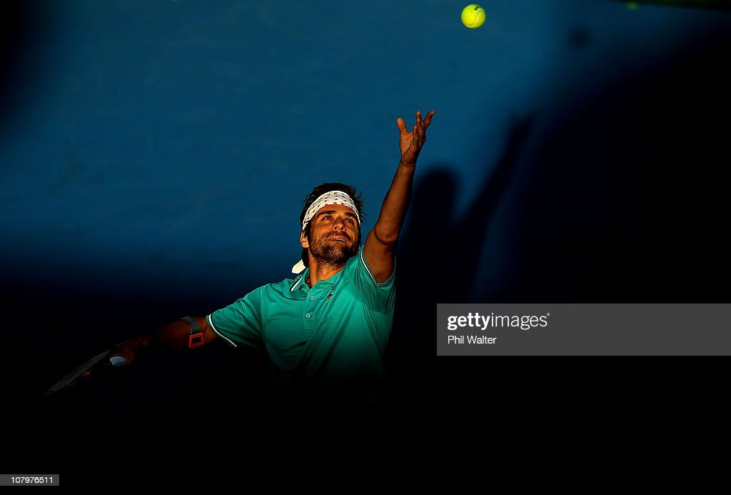 <a gi-track='captionPersonalityLinkClicked' href=/galleries/search?phrase=Arnaud+Clement&family=editorial&specificpeople=203192 ng-click='$event.stopPropagation()'>Arnaud Clement</a> of France serves during his match against Xavier Malisse of Belguim on day two of the Heineken Open at the ASB Tennis Centre on January 11, 2011 in Auckland, New Zealand.