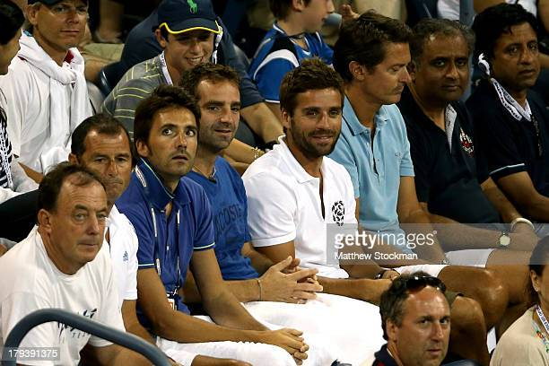 Arnaud Clement of France watches Richard Gasquet of France play Milos Raonic of Canada during their fourth round round men's singles match on Day...