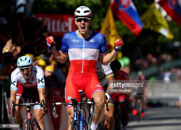 Arnaud Demare of France and and team FDJ celebrates as he crosses the finish line to win stage four of Le Tour de France 2017 on July 4 2017 in...