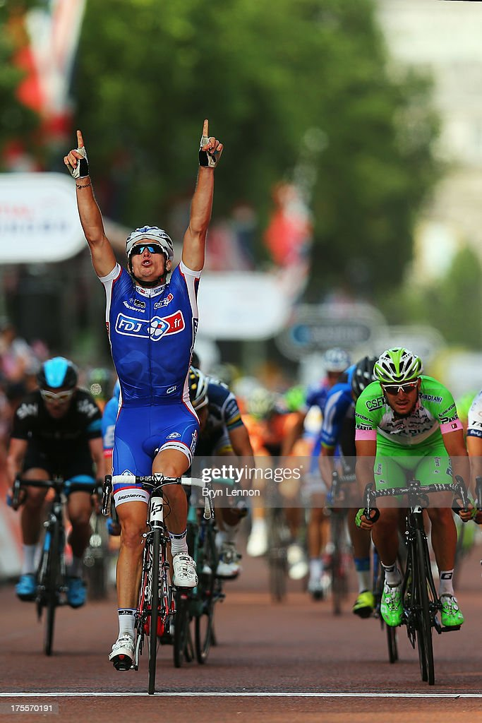 Arnaud Demare of France and FDJ crosses the finish line to win the London - Surrey Classic from the Queen Elizabeth Olympic Park to The Mall on August 4, 2013 in London, England.