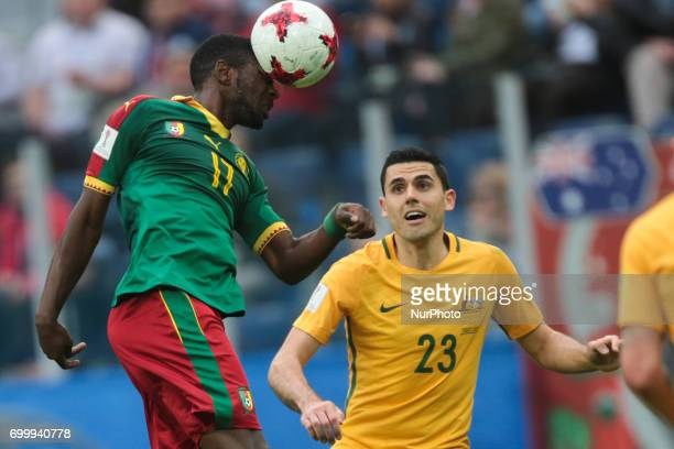 Arnaud Djoum of the Cameroon national football team and Tommy Rogic of the Australia national football team vie for the ball during the 2017 FIFA...