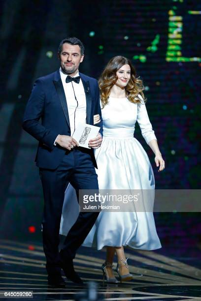 Arnaud Ducret and Alice Pol arrive on stage during the Cesar Film Awards Ceremony at Salle Pleyel on February 24 2017 in Paris France