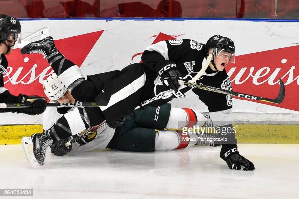 Arnaud Durandeau of the Halifax Mooseheads takes down Maxime Collin of the BlainvilleBoisbriand Armada during the QMJHL game at Centre d'Excellence...