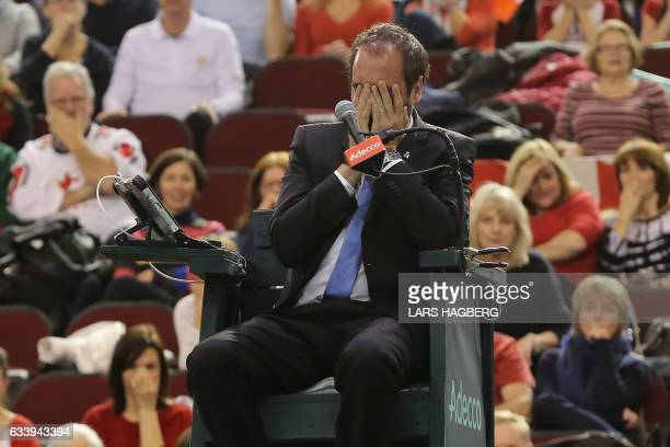 Arnaud Gabas from France covers his face after Denis Shapovalov of Canada accidently hit him with a tennis ball during the third set day of Davis Cup...