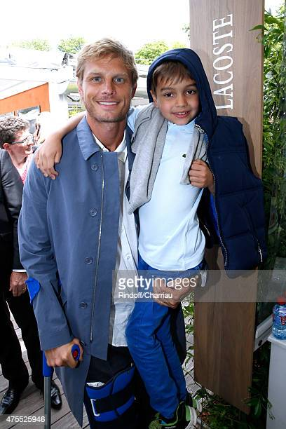 Arnaud Lemaire and his Godson Karl attend the 2015 Roland Garros French Tennis Open Day Nine on June 1 2015 in Paris France
