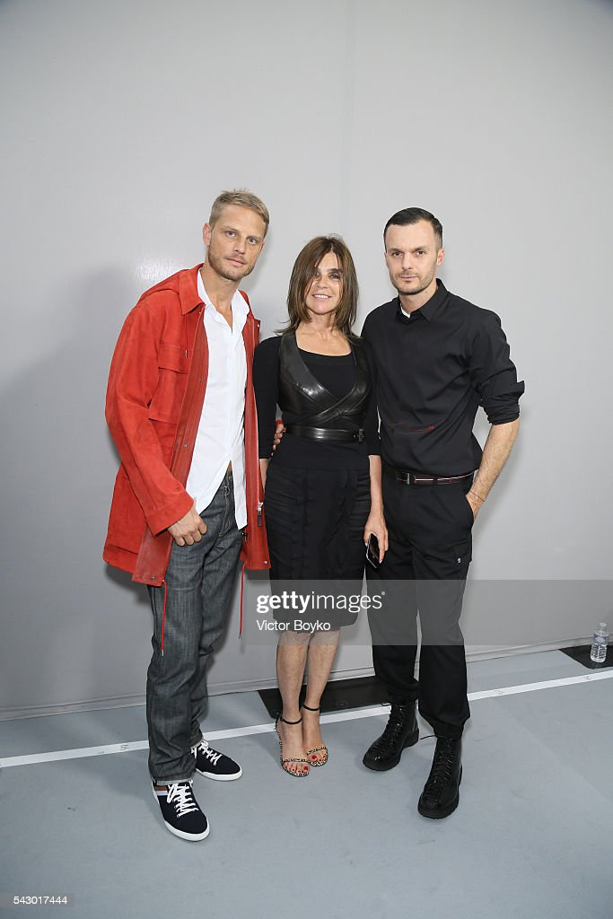 Arnaud Lemaire, Carine Roitfeld and Kris Van Assche pose in the backstage before the Dior Homme Menswear Spring/Summer 2017 show as part of Paris Fashion Week on June 25, 2016 in Paris, France.