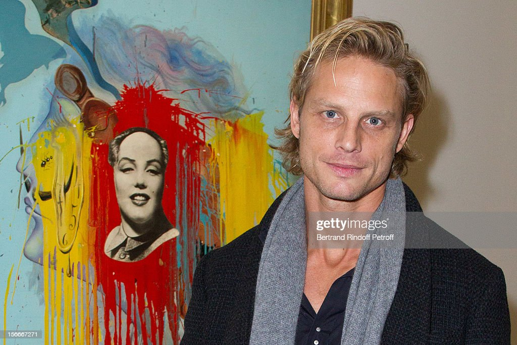 Arnaud Lemaire poses by Salvador Dali's 1972 'Mao-Marilyn' as he attends Dali Private Exhibition Preview at Centre Pompidou on November 18, 2012 in Paris, France.