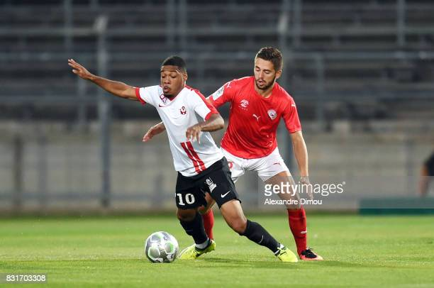 Arnaud Nordin of Nancy and Theo Valls of Nimes during the Ligue 2 match between Nimes Olympique and As Nancy Lorraine at Stade des Costieres on...