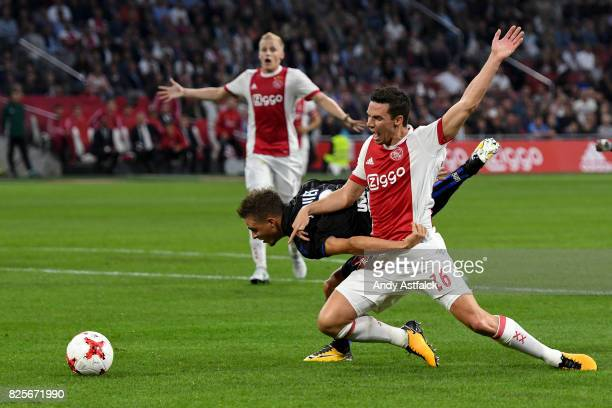 Arnaud Souquet from OSC Nice and Nick Viergever from AJAX fight for the ball during the UEFA Champions League Qualifying Third Round Second Leg match...