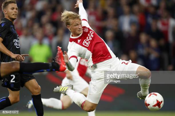 Arnaud Souquet of OCG Nice Kasper Dolberg of Ajax during the UEFA Champions League third round qualifying first leg match between Ajax Amsterdam and...