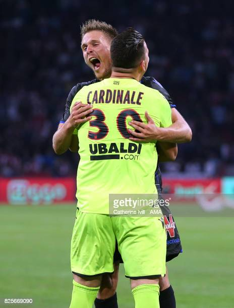 Arnaud Souquet of OGC Nice celebrates with Yoan Cardinale of OGC Nice during the UEFA Champions League Qualifying Third Round match between Ajax and...