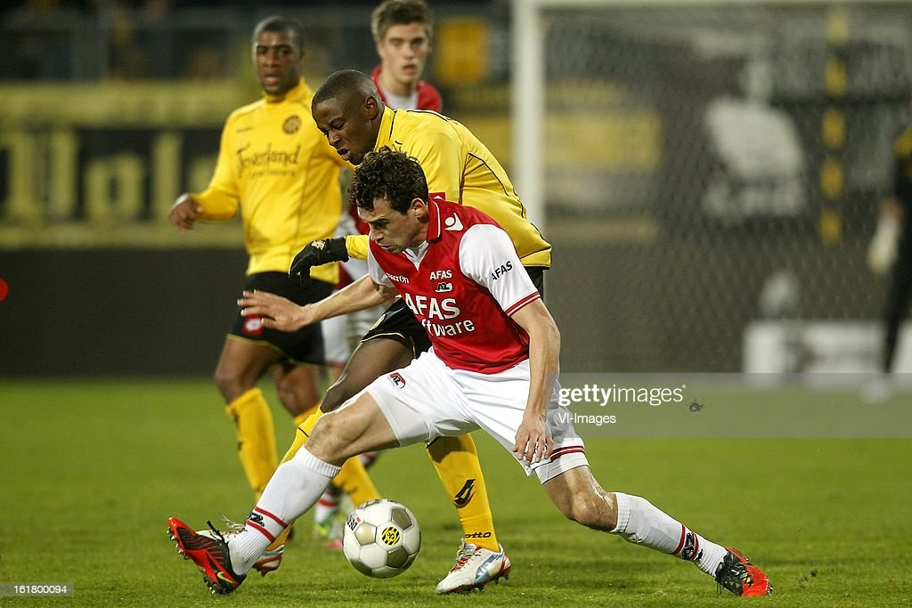 Arnaud Sutchuin Djoum of Roda JC (L), Dirk Marcellis of AZ (R) during the Dutch Eredivisie match between Roda JC Kerkrade and AZ Alkmaar at the Parkstad Limburg Stadium on february 16, 2013 in Kerkrade, The Netherlands