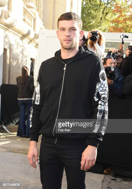 Arnaud Valois poses during the Chanel show as part of the Paris Fashion Week Womenswear Spring/Summer 2018 on October 3 2017 in Paris France