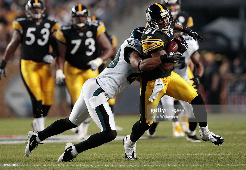 Arnaz Battle #81 of the Pittsburgh Steelers attempts to break a tackle from Nate Allen #29 of the Philadelphia Eagles after catching a pass during the preseason game on August 18, 2011 at Heinz Field in Pittsburgh, Pennsylvania.