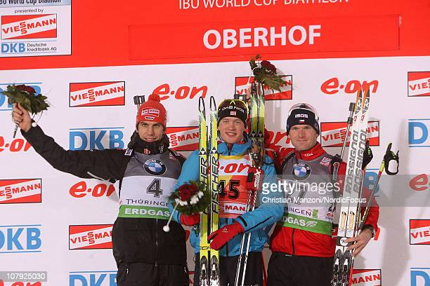 Arnd Peiffer of Germany celebrates with Tarjei Boe of Norway and Michal Slesingr of Czech Republic after the men's sprint during the eon IBU Biathlon...