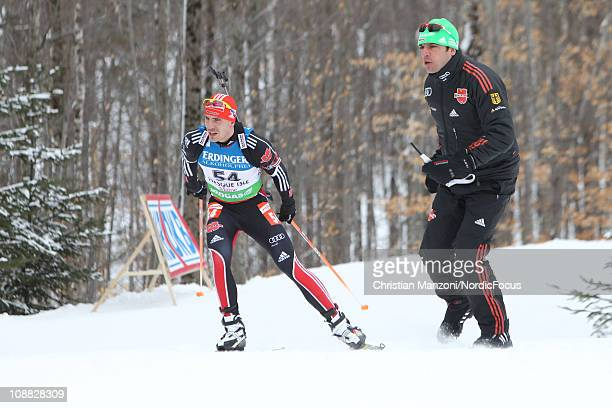 Arnd Peiffer of Germany competes with Rico Gross of Germany in the men's sprint during the EON IBU Biathlon World Cup on February 4 2011 in Presque...