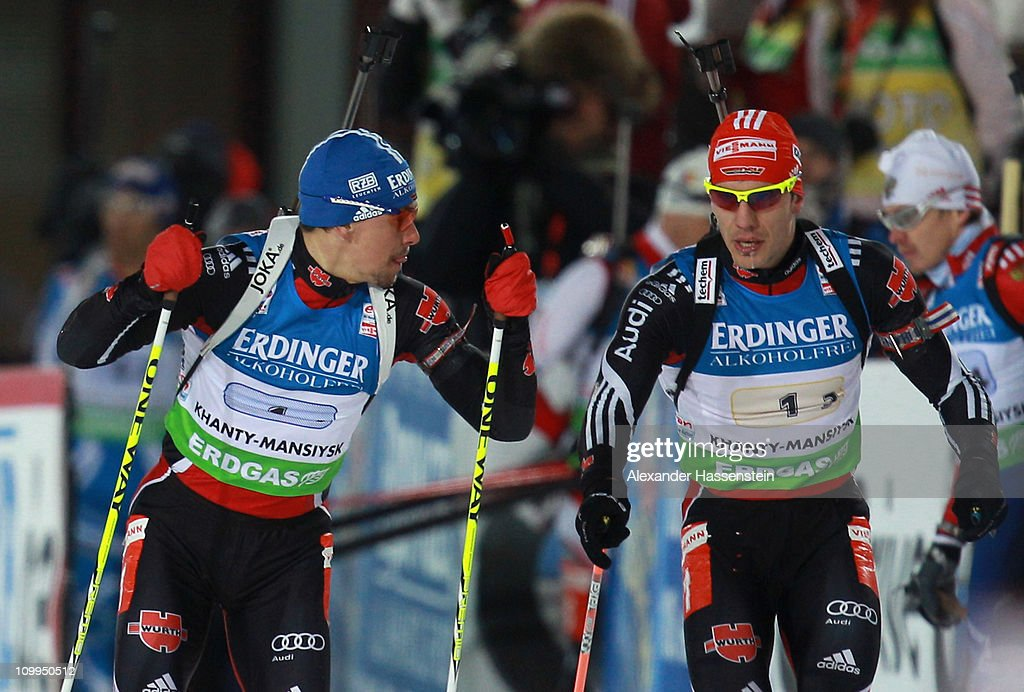 <a gi-track='captionPersonalityLinkClicked' href=/galleries/search?phrase=Arnd+Peiffer&family=editorial&specificpeople=5658801 ng-click='$event.stopPropagation()'>Arnd Peiffer</a> (R) of Germany hands over to his team mate <a gi-track='captionPersonalityLinkClicked' href=/galleries/search?phrase=Michael+Greis&family=editorial&specificpeople=702831 ng-click='$event.stopPropagation()'>Michael Greis</a> during the men's relay during the IBU Biathlon World Championships at A.V. Philipenko winter sports centre on March 11, 2011 in Khanty-Mansiysk, Russia.