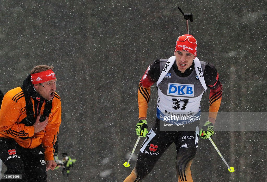 Arnd Peiffer of Germany is encouraged by his coach during the IBU Biathlon World Cup Men's Sprint on January 17, 2015 in Ruhpolding, Germany.