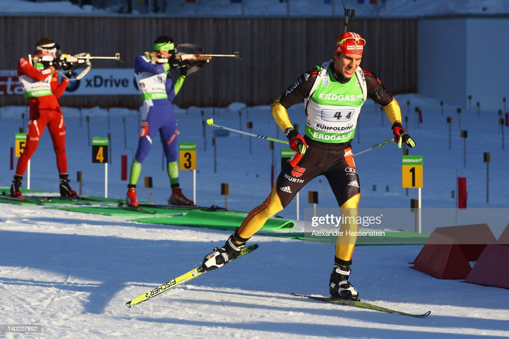 <a gi-track='captionPersonalityLinkClicked' href=/galleries/search?phrase=Arnd+Peiffer&family=editorial&specificpeople=5658801 ng-click='$event.stopPropagation()'>Arnd Peiffer</a> (R) of Germany leaves the shooting range whilst <a gi-track='captionPersonalityLinkClicked' href=/galleries/search?phrase=Jakov+Fak&family=editorial&specificpeople=5644158 ng-click='$event.stopPropagation()'>Jakov Fak</a> (C) of Slovenia and <a gi-track='captionPersonalityLinkClicked' href=/galleries/search?phrase=Emil+Hegle+Svendsen&family=editorial&specificpeople=831528 ng-click='$event.stopPropagation()'>Emil Hegle Svendsen</a> (L) of Norway comeptes during the IBU Biathlon World Championships Mixed Relay on March 1, 2012 in Ruhpolding, Germany.