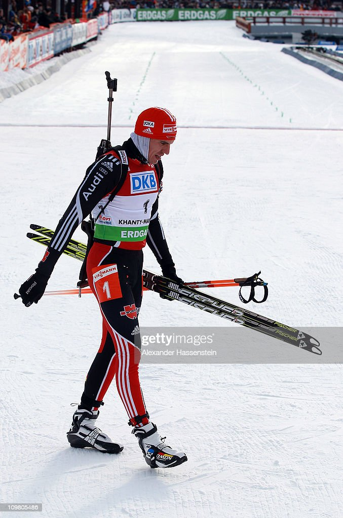 Arnd Peiffer of Germany reacts at the finish area after the men's 125km pursuit during the IBU Biathlon World Championships at AV Philipenko winter...