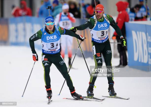 Arnd Peiffer of Germany sends Simon Schempp of Germany on the track during the Men's 4x75km relay competition of the BMW IBU World Cup Biathlon on...