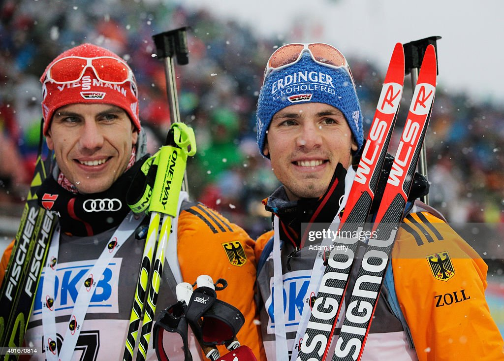 Arnd Peiffer of Germany third place and Simon Schempp of Germany second place celebrate after the IBU Biathlon World Cup Men's Sprint on January 17, 2015 in Ruhpolding, Germany.