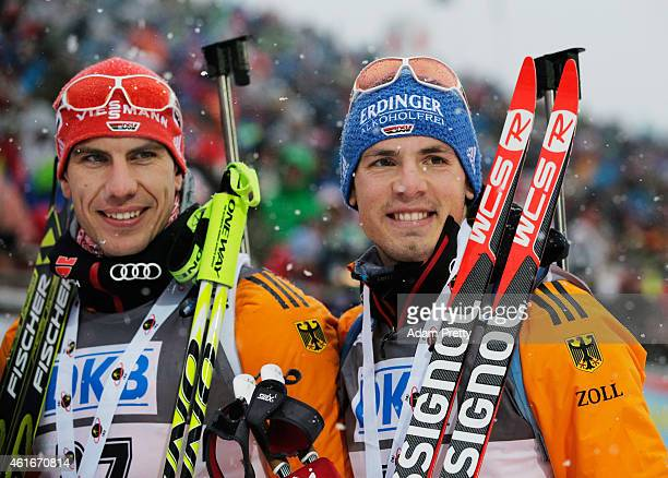 Arnd Peiffer of Germany third place and Simon Schempp of Germany second place celebrate after the IBU Biathlon World Cup Men's Sprint on January 17...