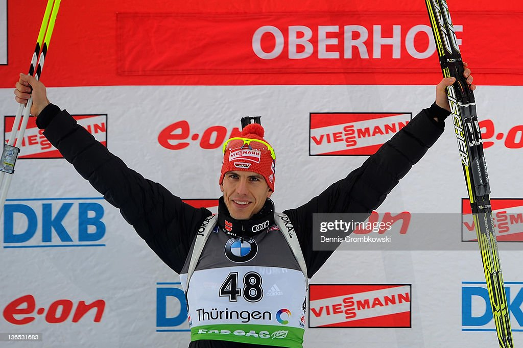 Arnd Pfeiffer of Germany celebrates at the podium after the IBU World Cup Biathlon Oberhof Men's Sprint Race at DKB Ski Arena on January 7 2012 in...