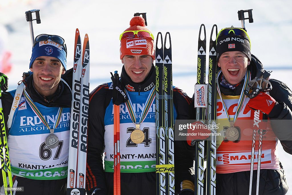 Arnd Pfeiffer of Germany Martin Fourcade of France and Tarjei Boe pose at the victory ceremony after the men's 10km sprint during the IBU Biathlon...