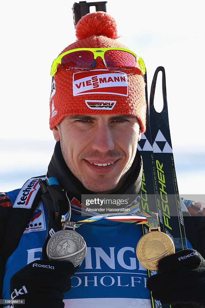 Arnd Pfeiffer of Germany poses with his gold medal for the men's 10km sprint and his silver medal won at the mixed relay during the IBU Biathlon...